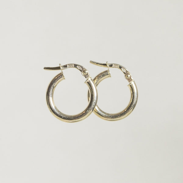 slightly different - lovely round edged hoops in real gold also available on our website