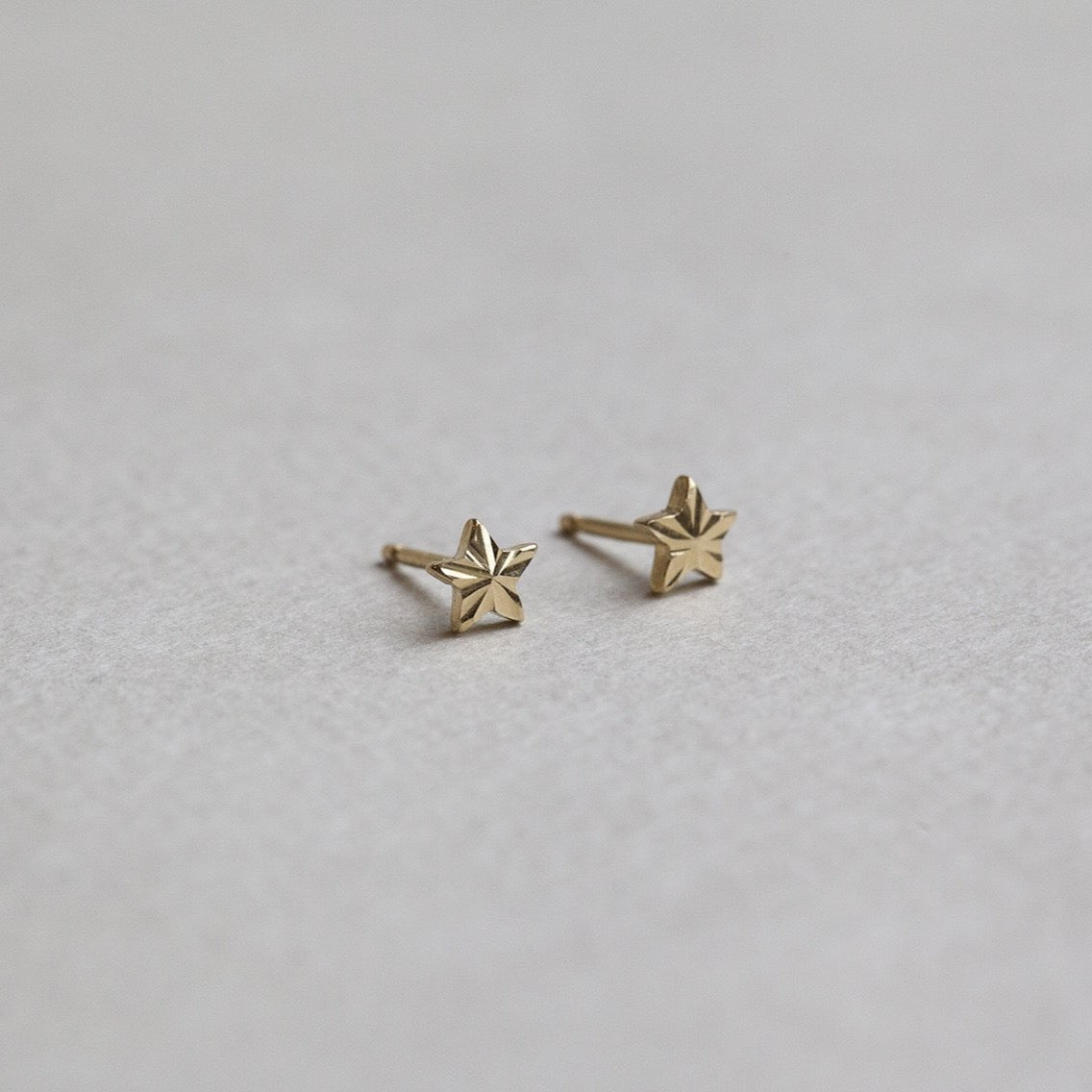 from the same collection - 9 carat gold micro star stud earrings also available on feltlondon.com