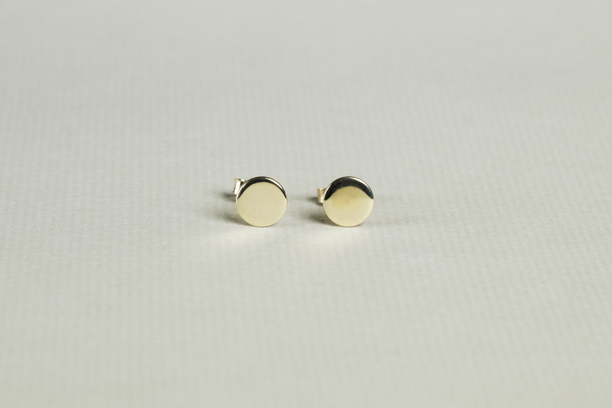back hoop rounded our post a large earrings stud feature these hoops p tubular in favorite gold pin are