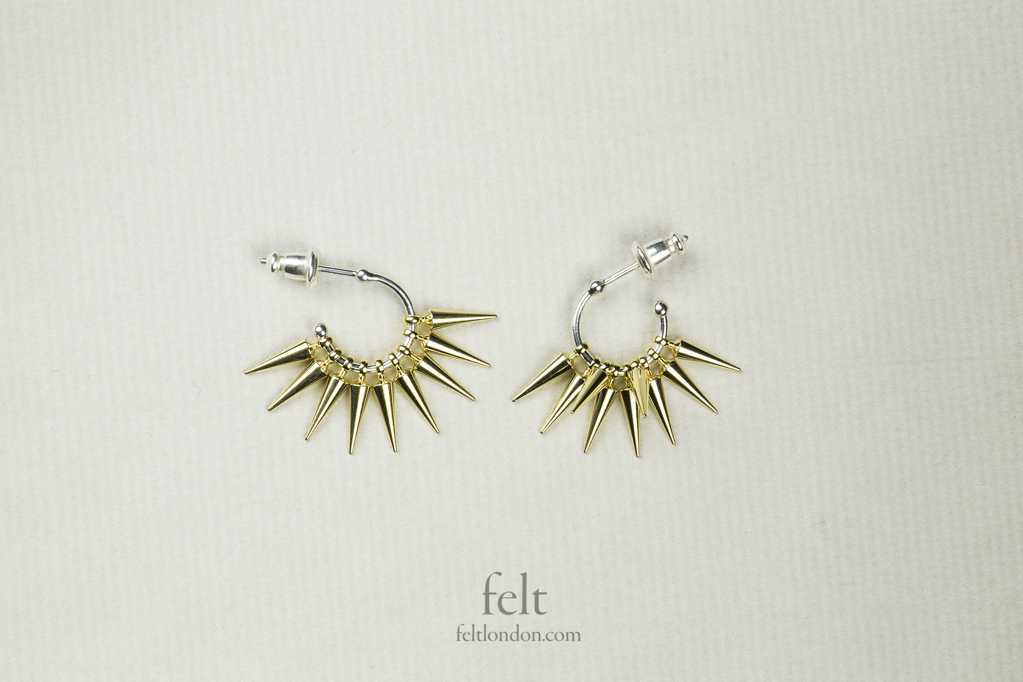 Spiked cluster earrings also available at felt