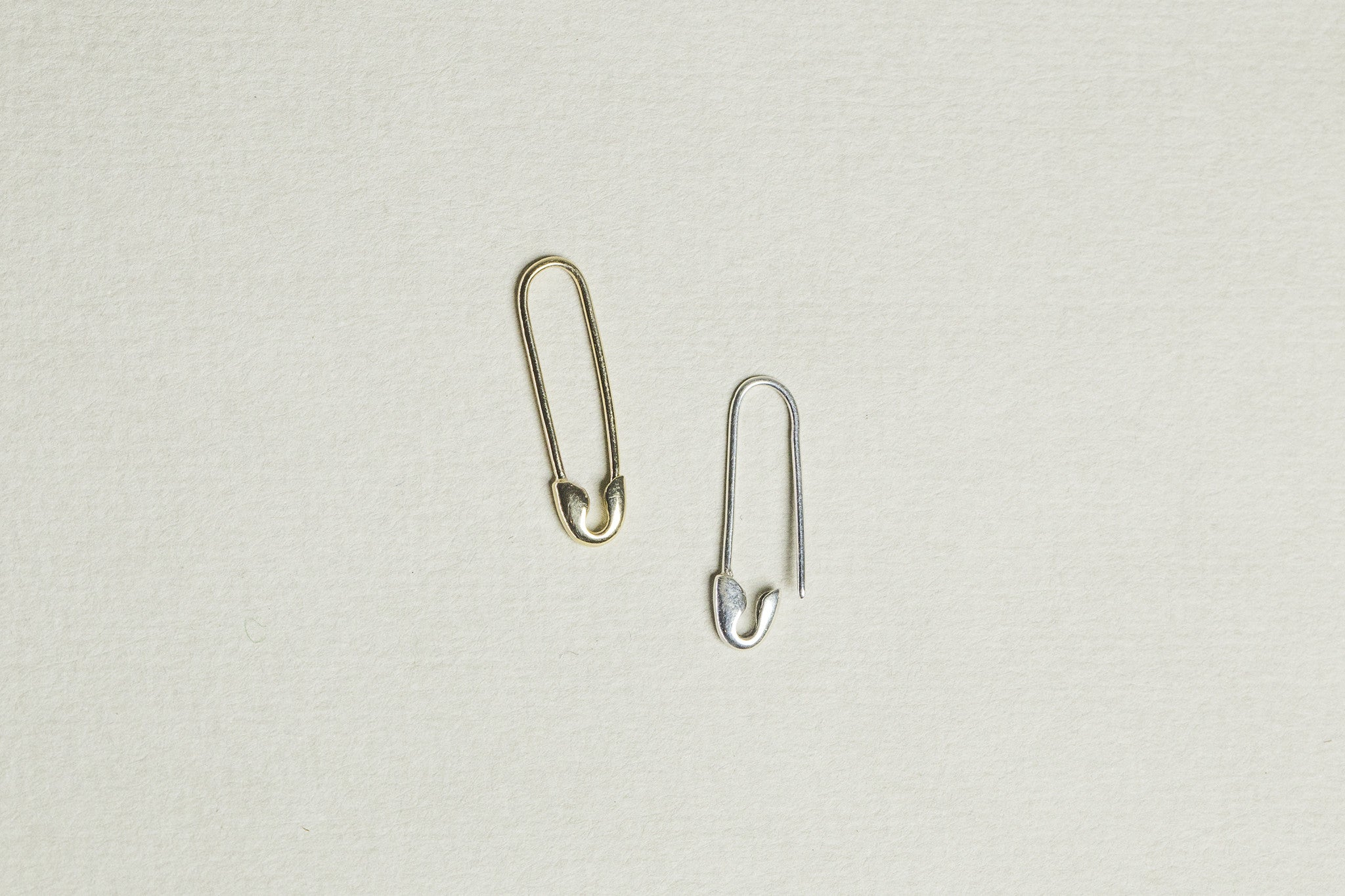 also available is a plain version - either 9 carat gold or sterling silver, sold in pairs