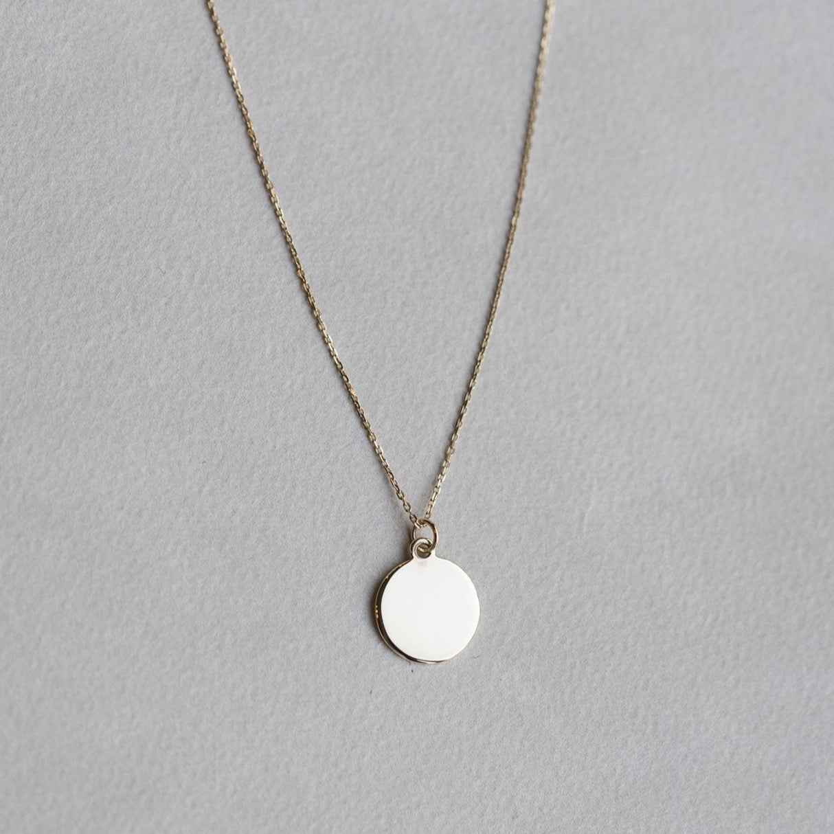 felt's own design - incredibly simple and enchanting polished gold disc