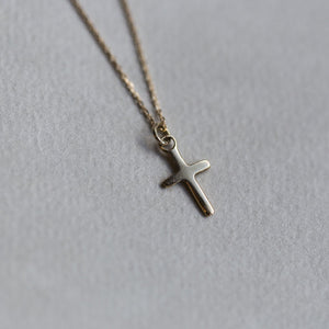 felt's very own design - adorable tiny cross pendant