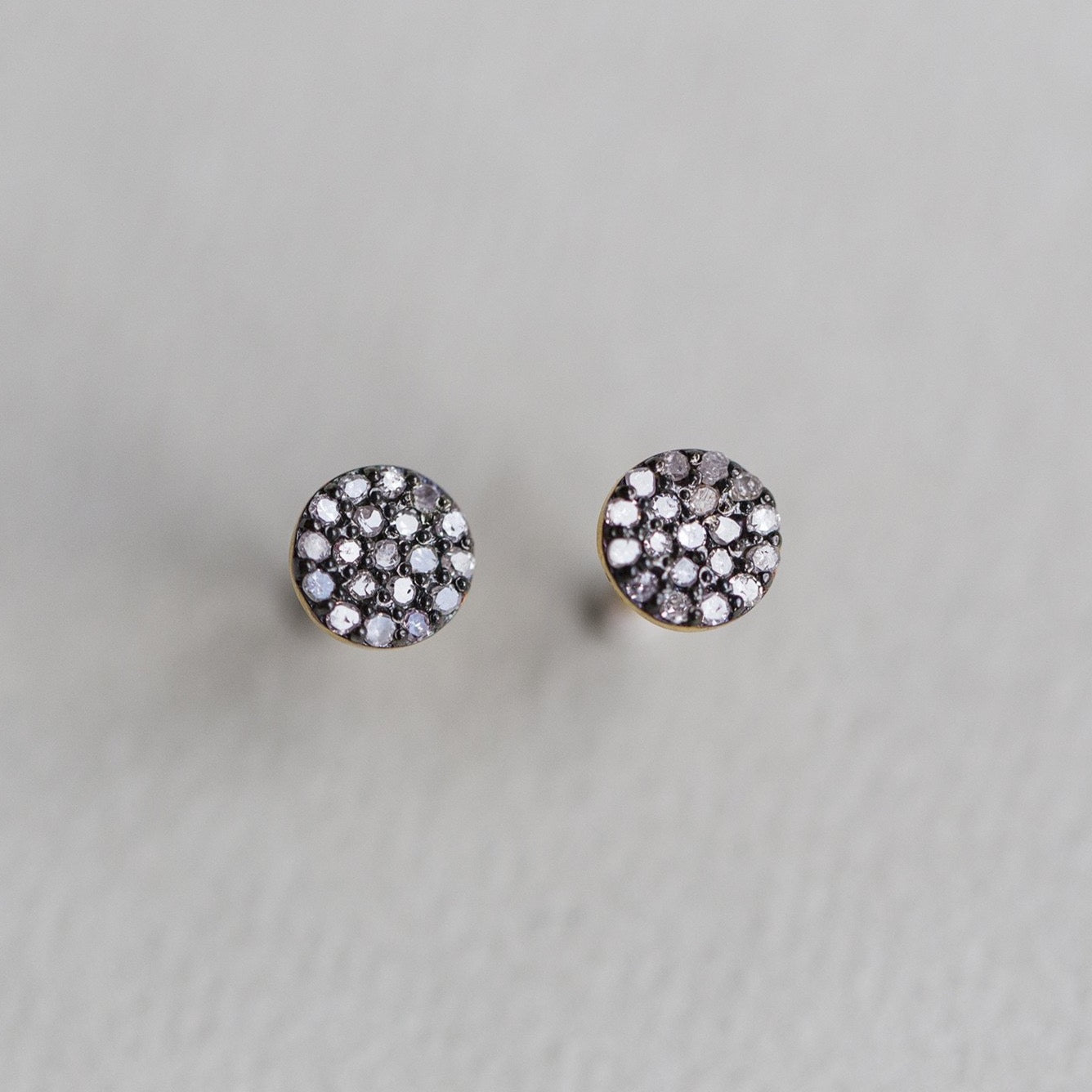 felt Affordable Diamond Range diamond pave disc earrings set on oxidised silver and with gold posts