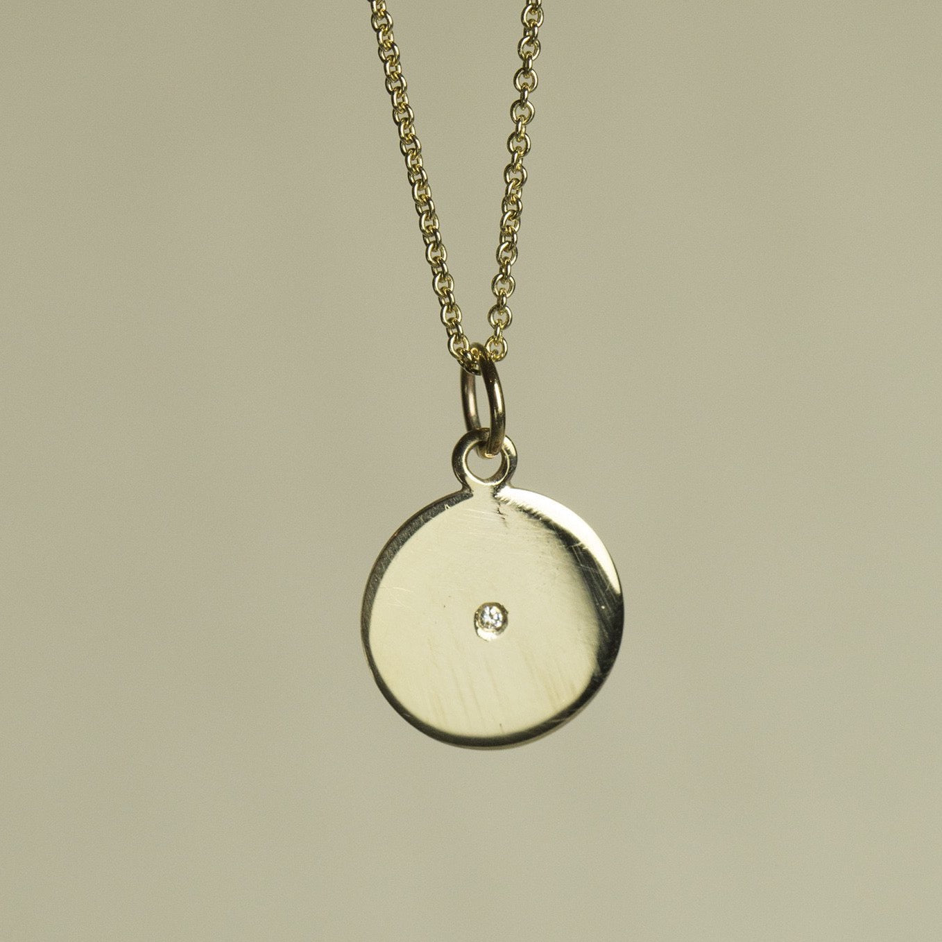 felt's own design - incredibly simple and enchanting polished gold disc with diamond on 9 carat gold chain