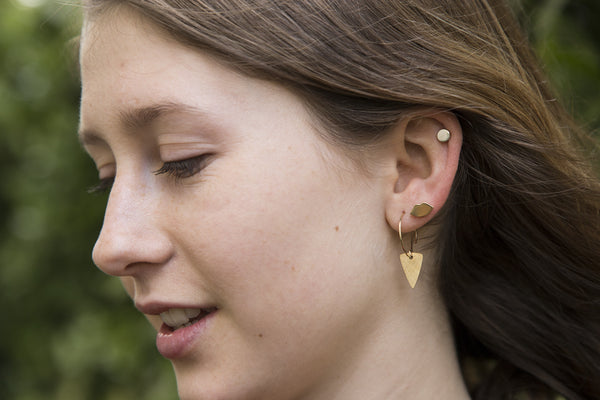 the fantastic arrow heads hoops are complemented by Laura Gravestock lips studs and felt's own silver disc studs.
