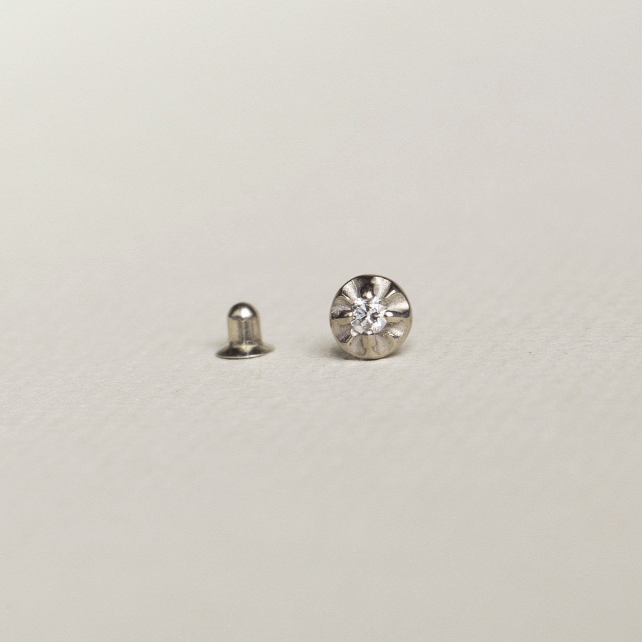 eclectic, vintage inspired starburst earring in white gold