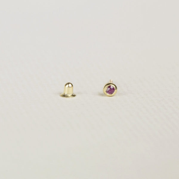 adorable tiny ruby screw back earring