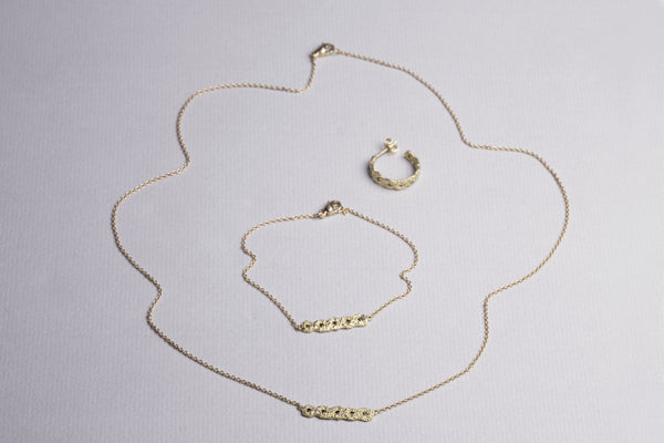 A matching set - necklace, bracelet and hoops