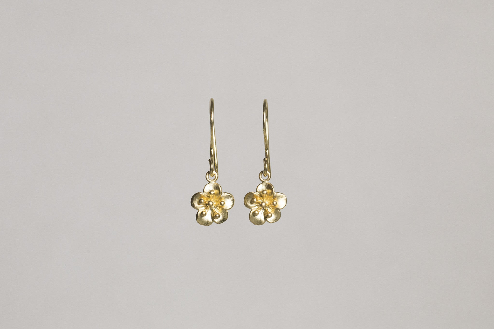 adorable sakura gold plated drop earrings by Mirabelle