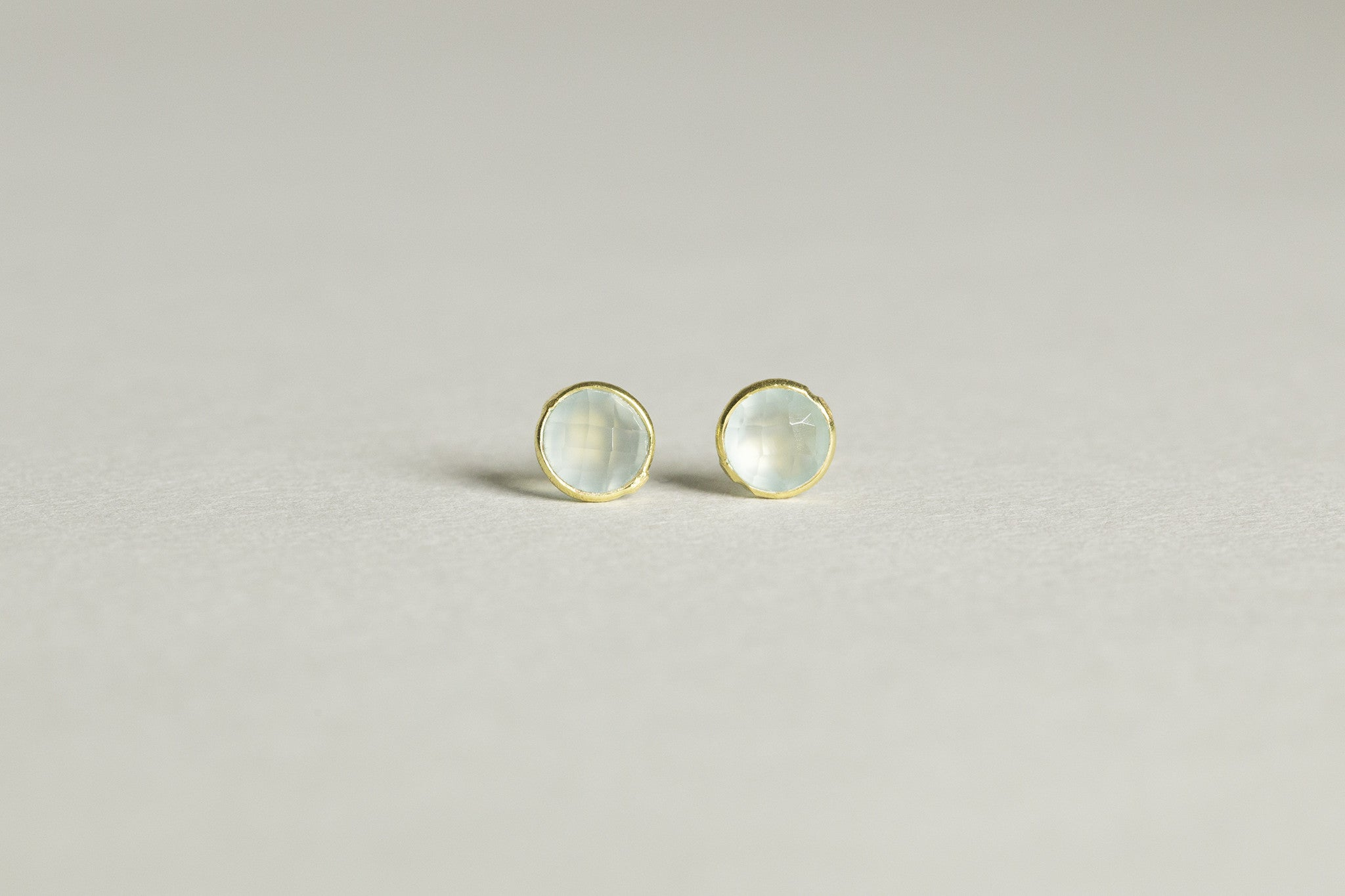 gorgeous and bright - pale green chalcedony stones encapsulated in gold plated silver