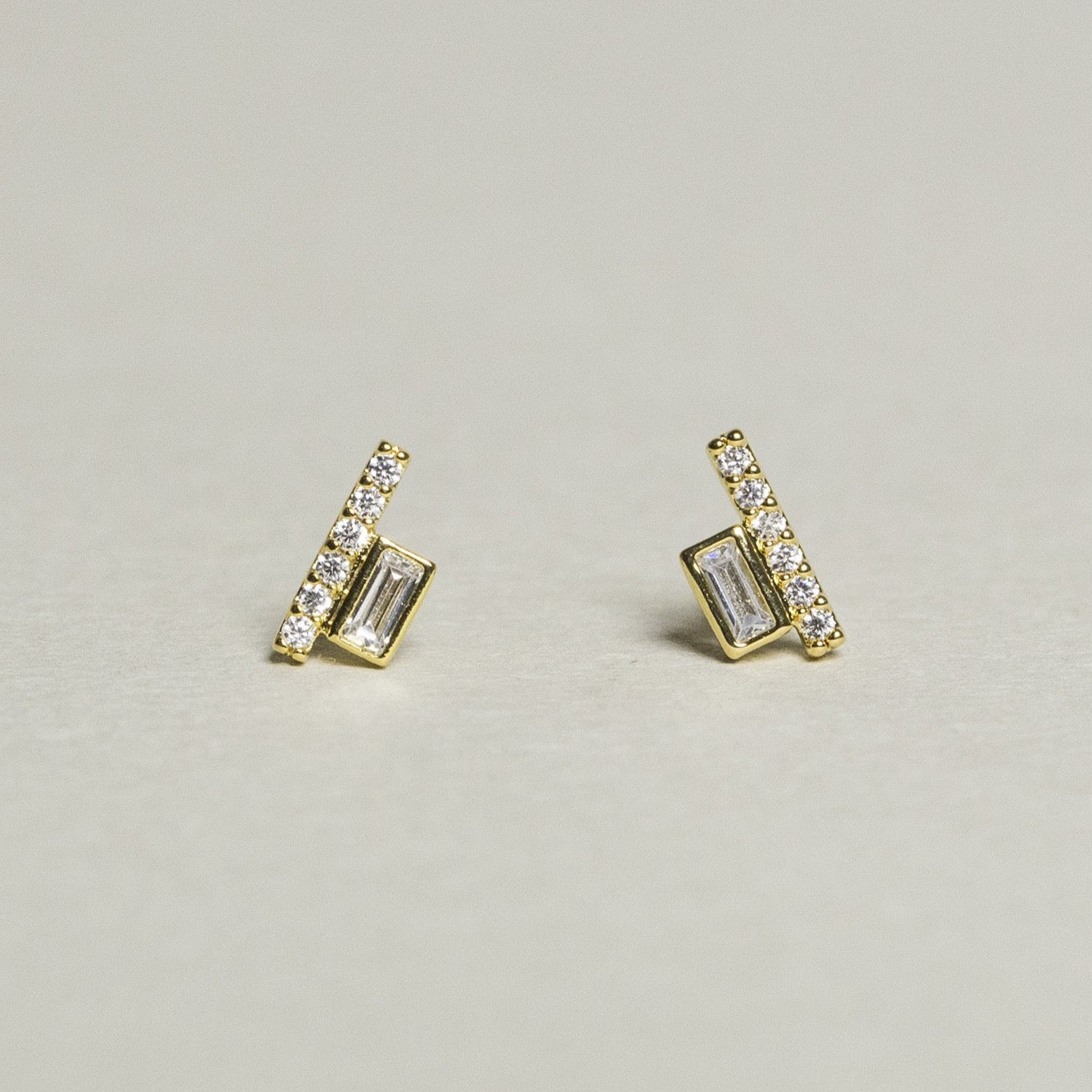 quirky yet elegant baguette rectangular and brilliant cut line studs