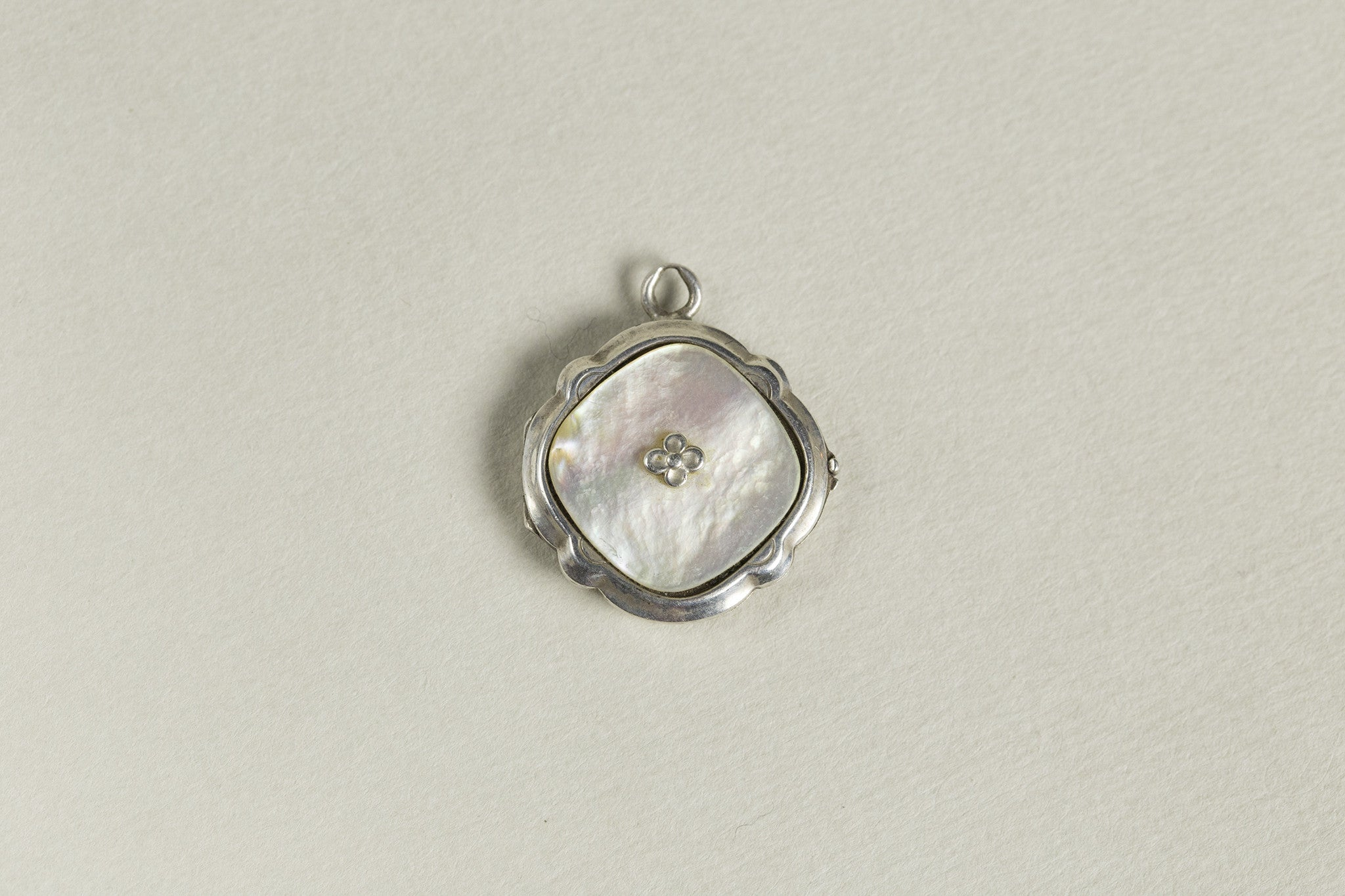 Silver Locket with Mother of Pearl and Silver Flower