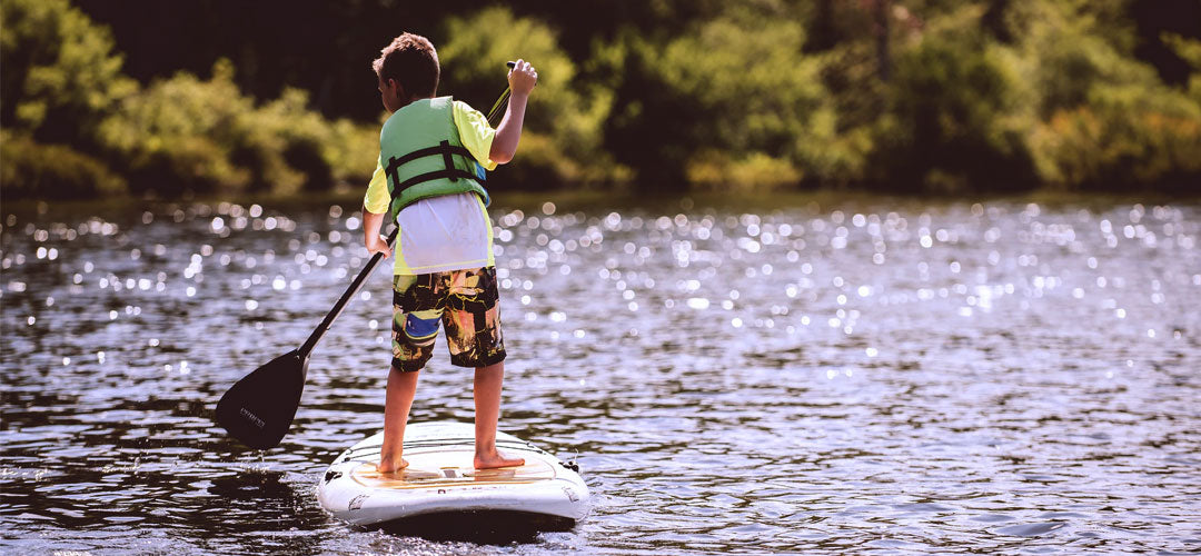 kid paddle boarding