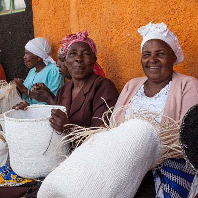 Kenyan artisans handmaking baskets from sustainable materials