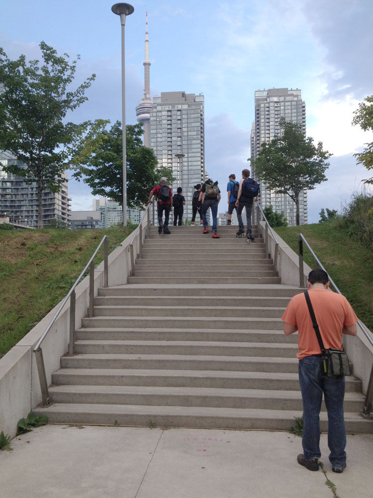 Walking up stairs on inline skates at Canoe Landing in Toronto