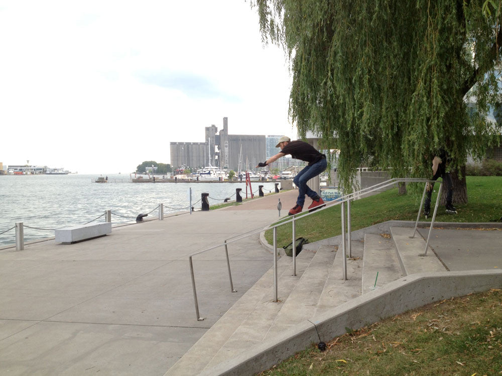 Erik Burrow inline skating down a handrail at HTO Park West in Toronto