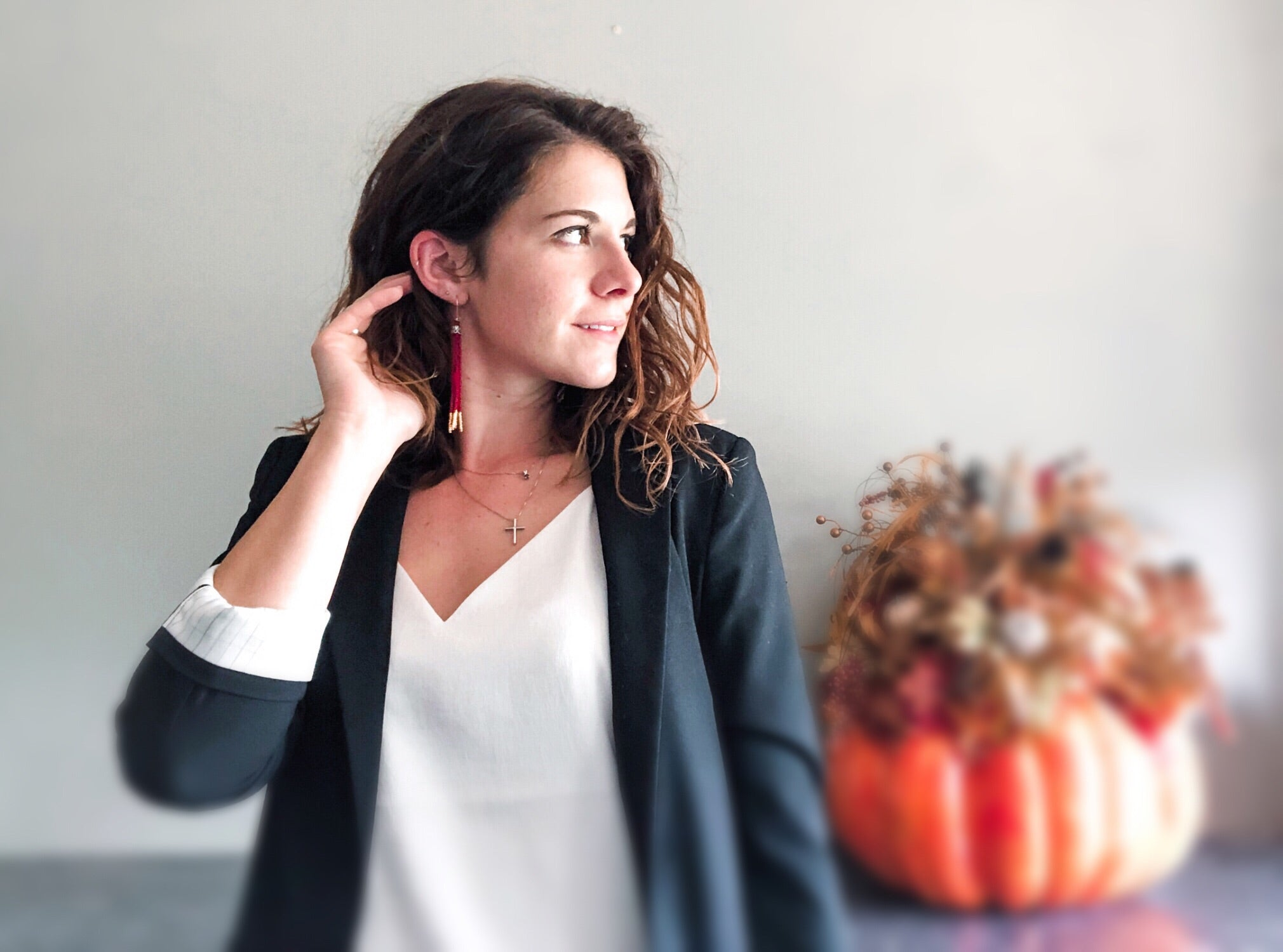 Cait wearing the sweater weather dip earrings, a black blazer and white shirt
