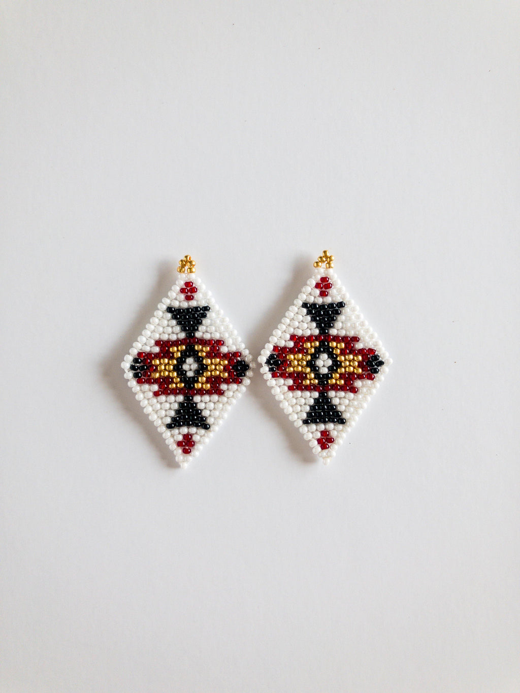 Seed bead earrings with white, black, red and gold seed beads diamond shape