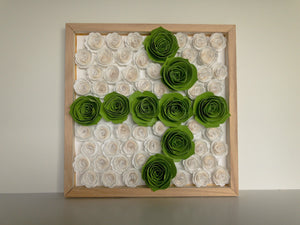 Wood frame with white and green paper flowers in arrow shape