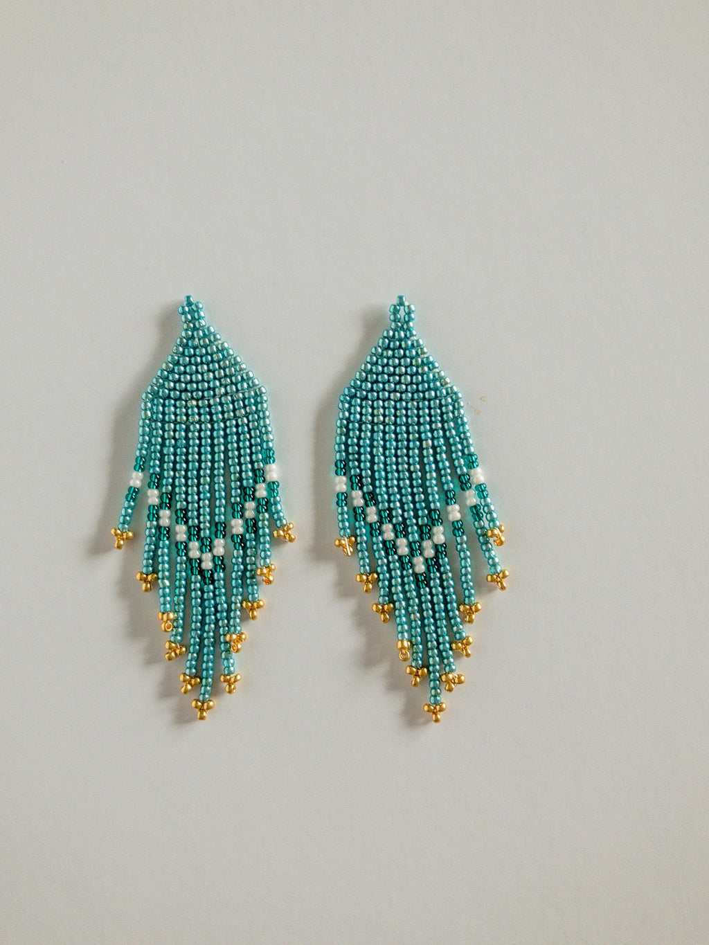 Seed bead earrings with blue, gold and white beads