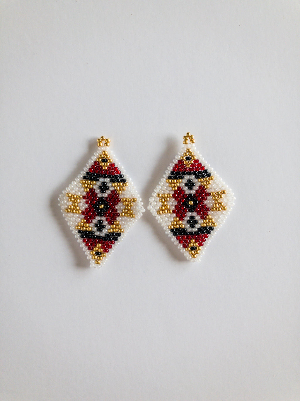 Diamond shaped seed bead earrings with red, gold, black and white beads