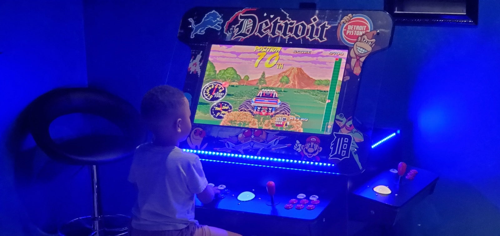 Kids Playing Games at Cocktail Arcade Table