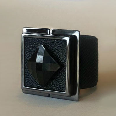 "The Scarf Lock is the modern version of any scarf ring, scarf pin or scarf clips. The front design is made of Black Leather and Black Crystal Stone. The piece consists of a secure magnetic clasp. All you do is slide either side of the magnetic clasp to lock and unlock. The 3/4 "" Black Elastic Strap is available in 2 sizes: Size"