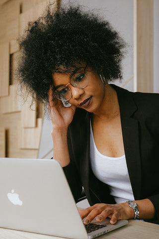 Black Woman Stressed at Her Laptop