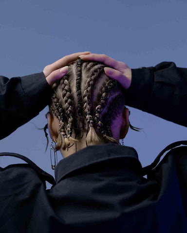 Photo of Woman Holding Scalp with Cornrows Photo by Nadezhda Diskant from Pexels