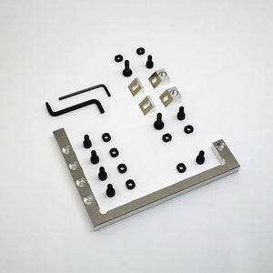 This set of CNC fixturing accessories provides rigid, consistent workholding without the use of tape or glue.