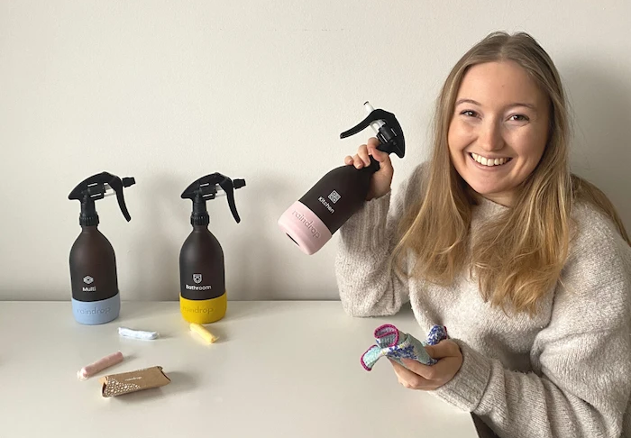 Woman holding Raindrop plastic free cleaning products