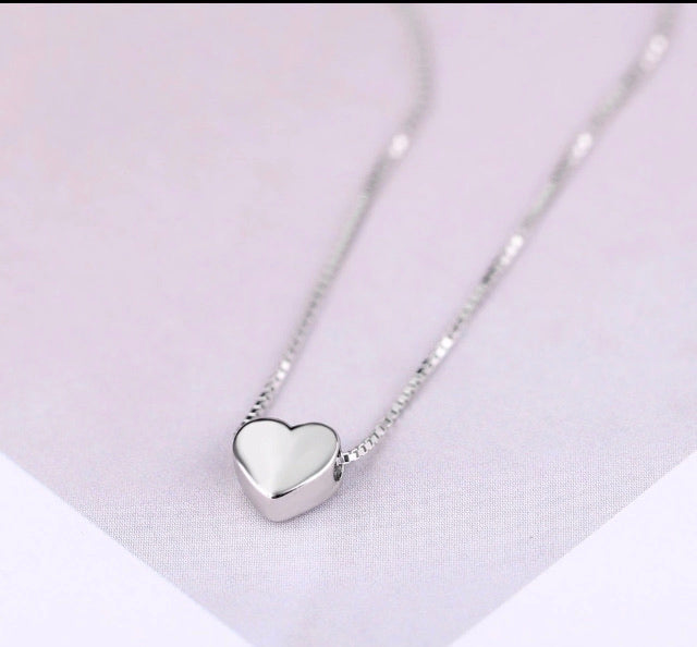 Cosmetic silver heart necklace