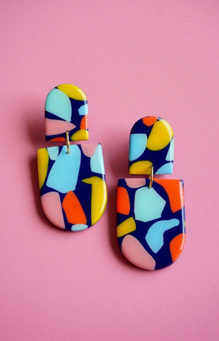 Bold statement drop style quirky earrings in navy and rainbow coloured terrazzo print inspired by cali-cool Palm Springs style. Handmade ear rings and jewellery by Studio Ides