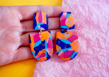 Load image into Gallery viewer, Statement Dangle Earrings in a Rich Blue, Orange, Pink and Turquoise Abstract Camouflage Pattern Studio Ides