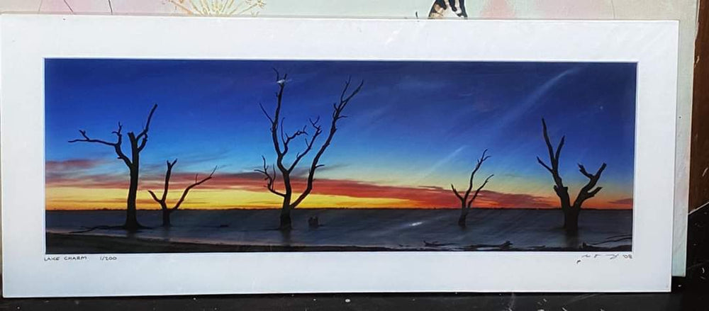 Unframed Photo of Dead Trees & Lake at Sunset
