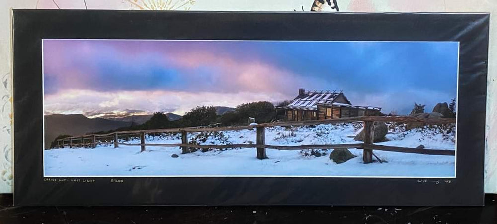 Unframed Photo of Solitary Hut in Snow