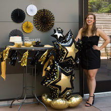"Load image into Gallery viewer, 59"" AirLoonz Black & Gold Star Cluster Balloon"