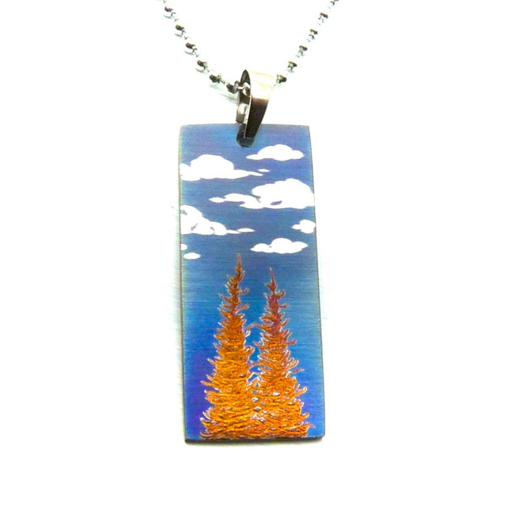 Two golden trees and white fluffy clouds on a blue sky necklace.
