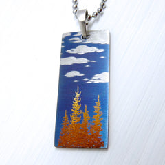 BLUE bar necklace with silver clouds and gold trees.