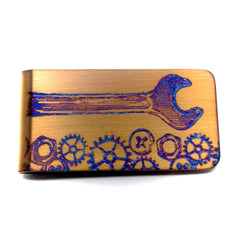 Gold trades money clip.