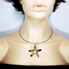 STARFISH NECKLACE. Hammered and heat tempered from gold to blue. On Molly.