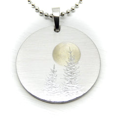 Silver tree pendant with a full moon.