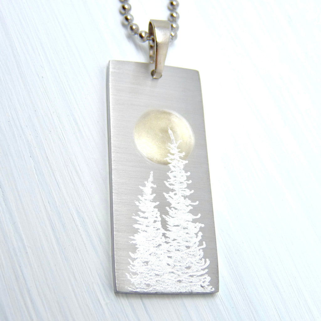 Silver bar necklace with silver trees and a full moon.