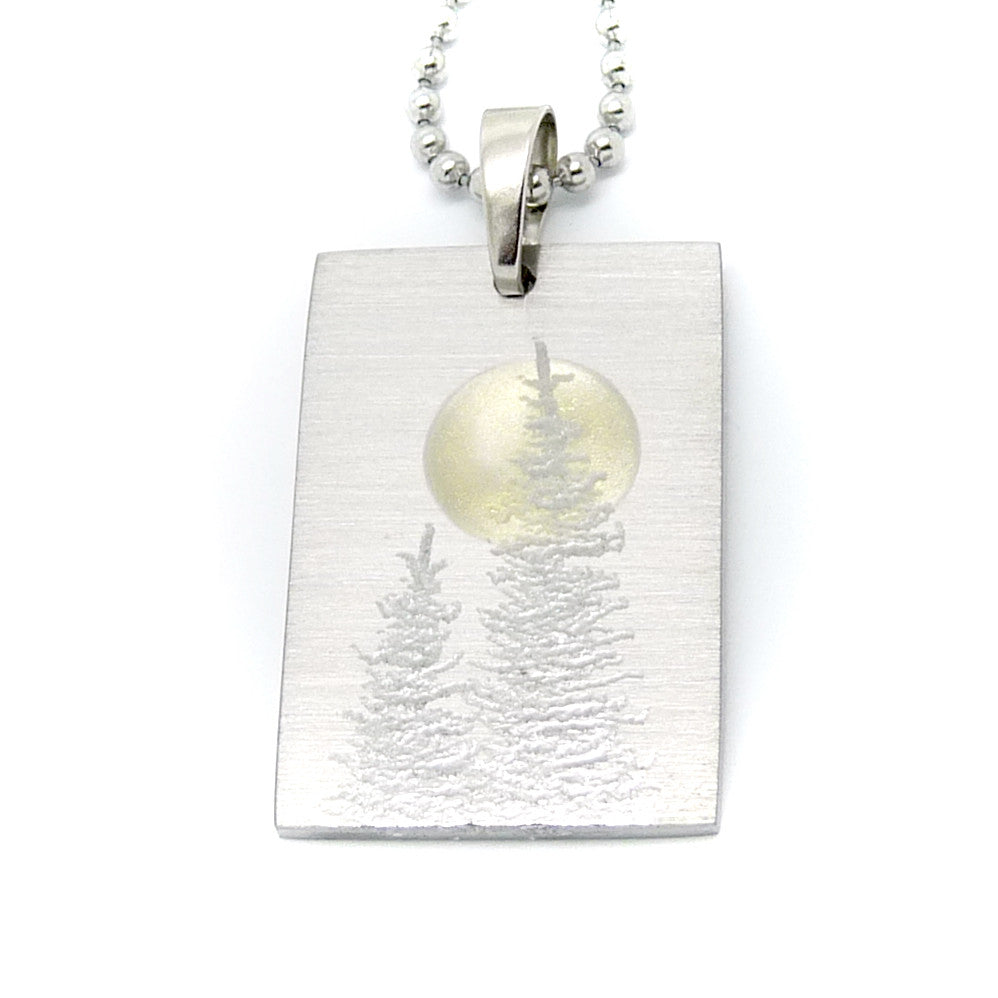 Two silver trees on a rectangle necklace.  Full Moon.