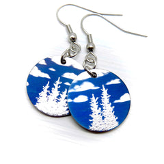 Blue skies and fluffy clouds with evergreen trees. Round earrings.