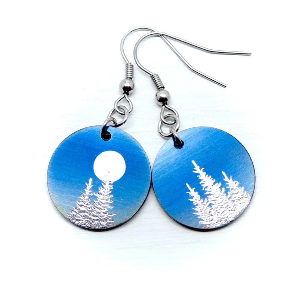 Blue earrings with silver trees and a full moon