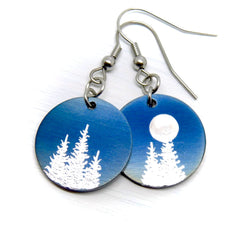 Silver trees on round blue earrings.