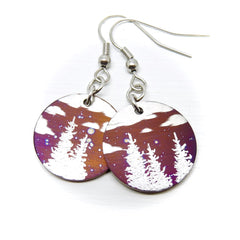 Evergreen trees and clouds on round earrings.