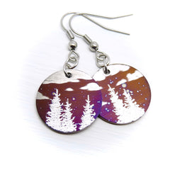 Round earrings with trees and clouds.